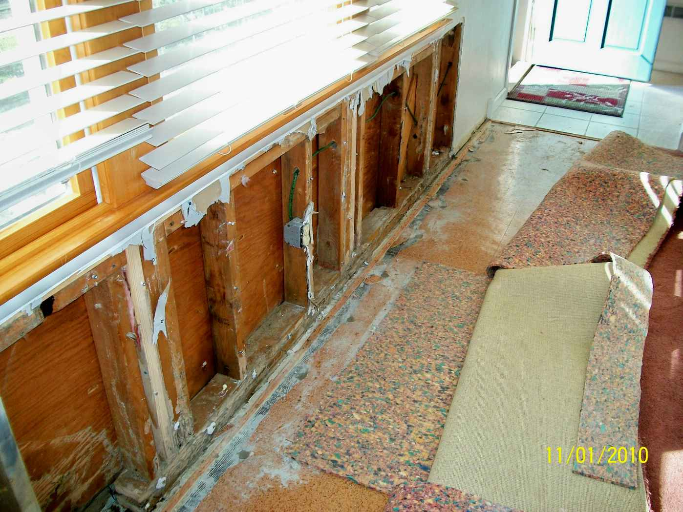 Termite Damaged baseboards, sill plates, wall studs, jack studs and headers
